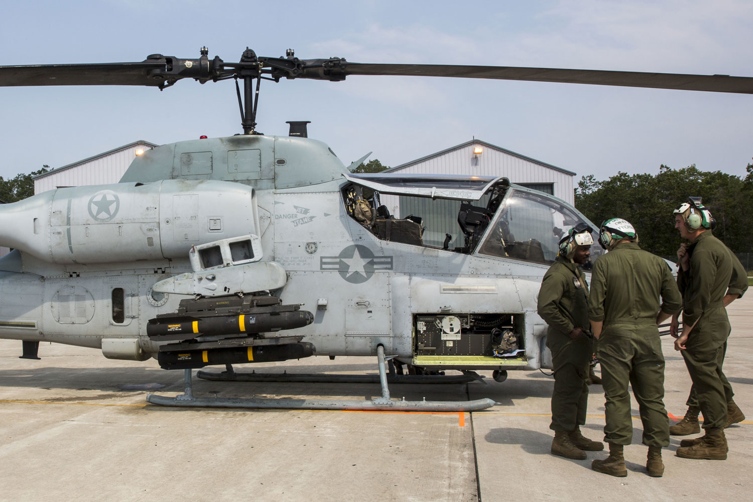 U.S. Marines with Marine Light Attack Helicopter Squadron 269 prepare to service an AH-1W Super Cobra at the Combat Readiness Training center Alpena, MI.
