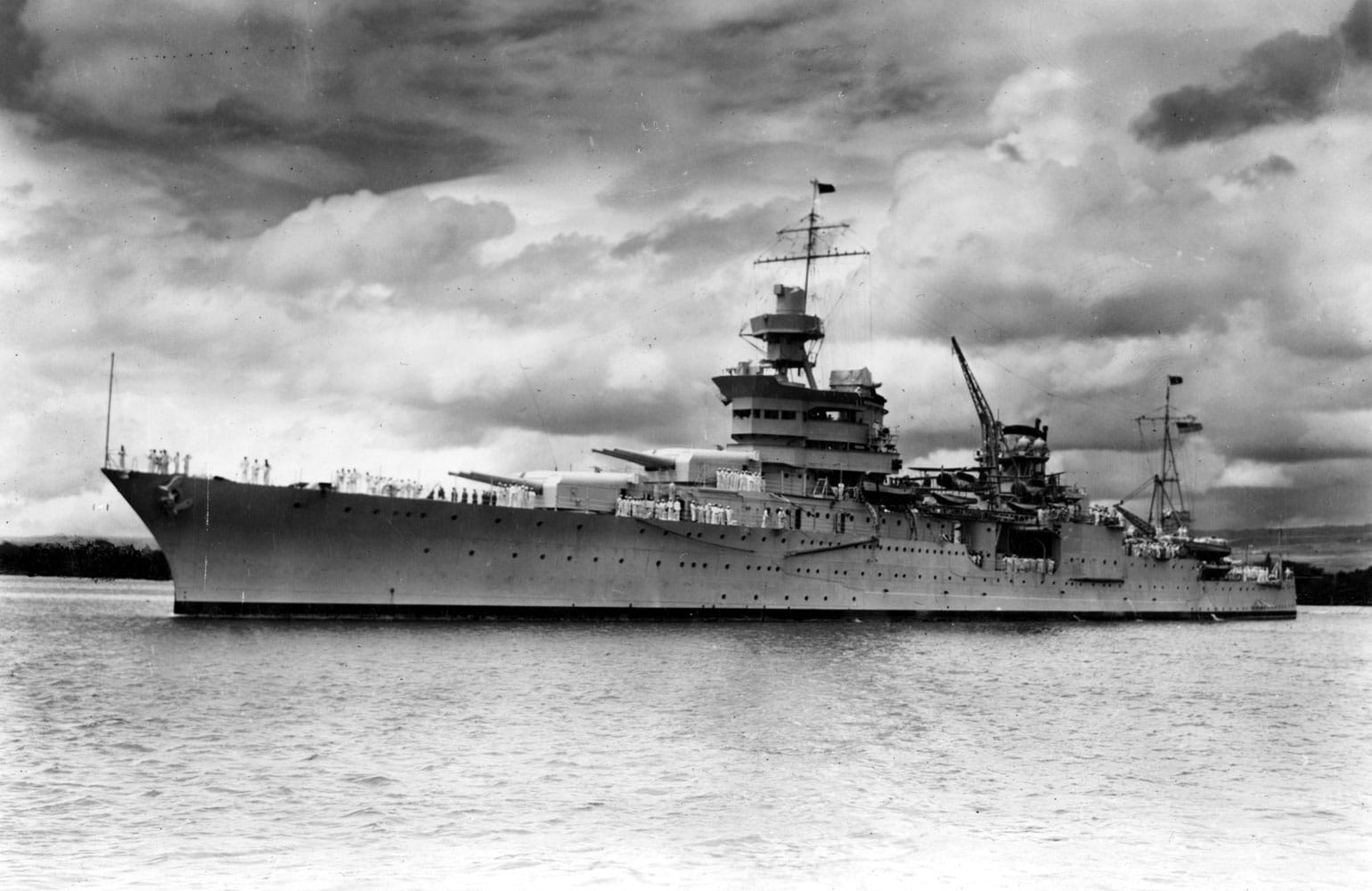 The United States Navy Portland-class heavy cruiser USS Indianapolis underway in Pearl Harbor in 1937. The ship was sunk on July 30, 1945 by an Imperial Japanese submarine in the Philippine Sea following delivery of parts for Little Boy, the first atomic bomb used in combat, to the United States air base at Tinian.