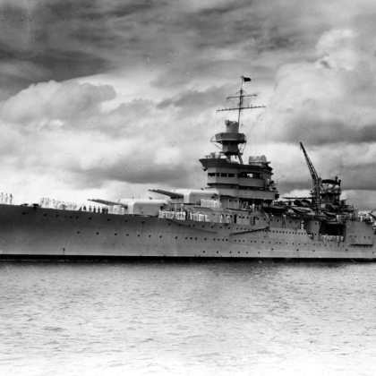 The Portland-class heavy cruiser USS Indianapolis (CA 35) underway in Pearl Harbor in 1937. The ship was sunk on July 30, 1945 by an Imperial Japanese submarine in the Philippine Sea following delivery of parts for Little Boy, the first atomic bomb used in combat, to the United States air base at Tinian. Of 1,196 crewmen aboard, approximately 300 went down with the ship. The remaining 900 faced exposure, dehydration, saltwater poisoning, and shark attacks while floating with few lifeboats and almost no food or water.