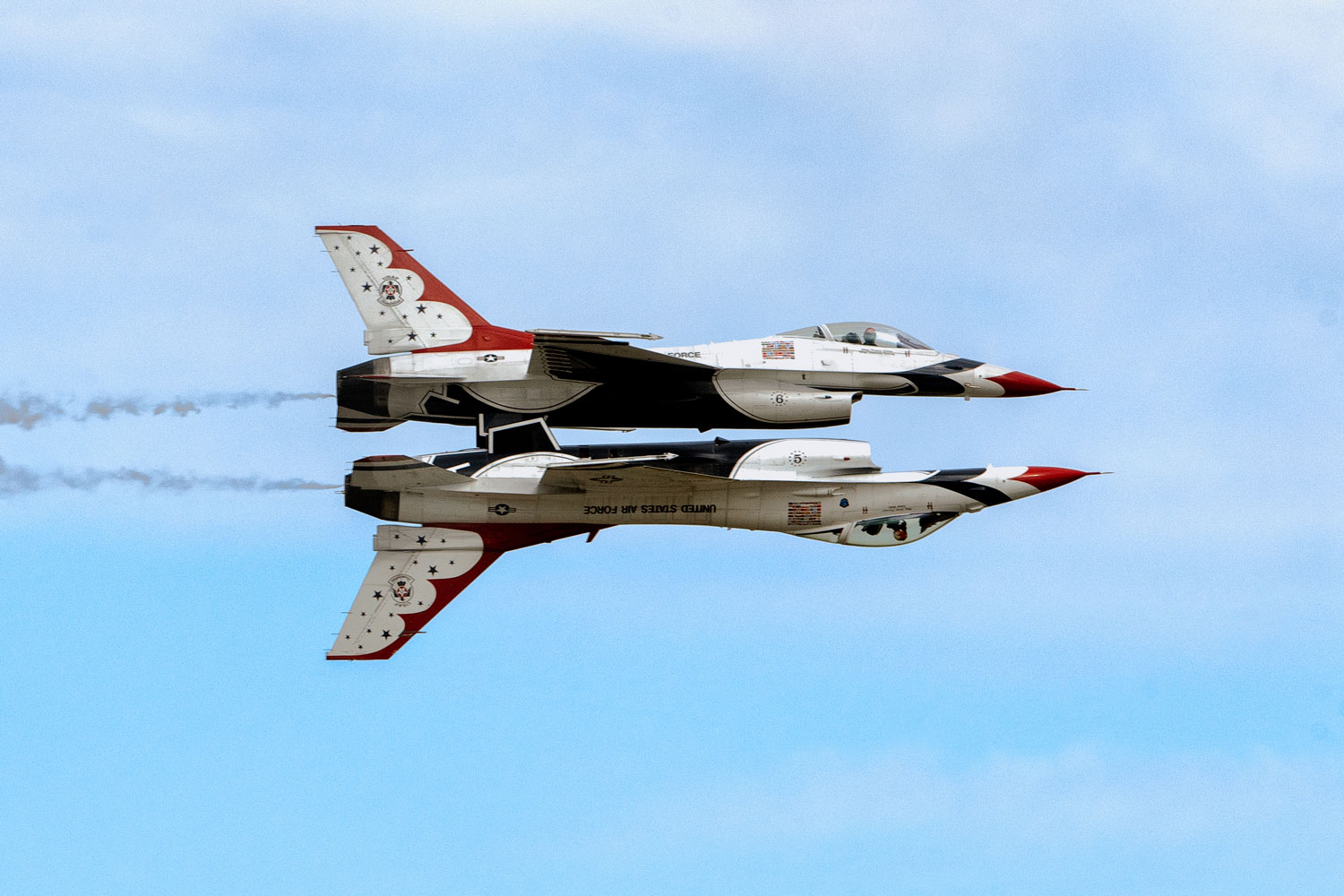 U.S. Air Force Thunderbirds perform a mirror-image maneuver during the 2017 Andrews Air Show: Air and Space Expo.