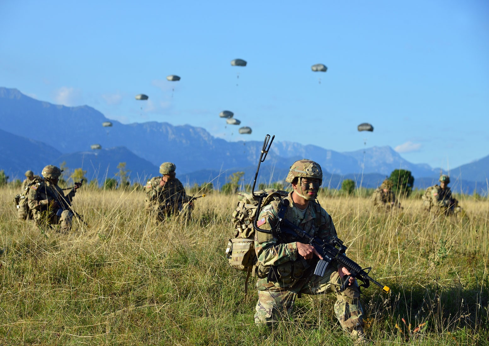 US Army Paratroopers assigned to the Brigade Support Battalion, 173rd Airborne Brigade, provide security after an airborne operation.