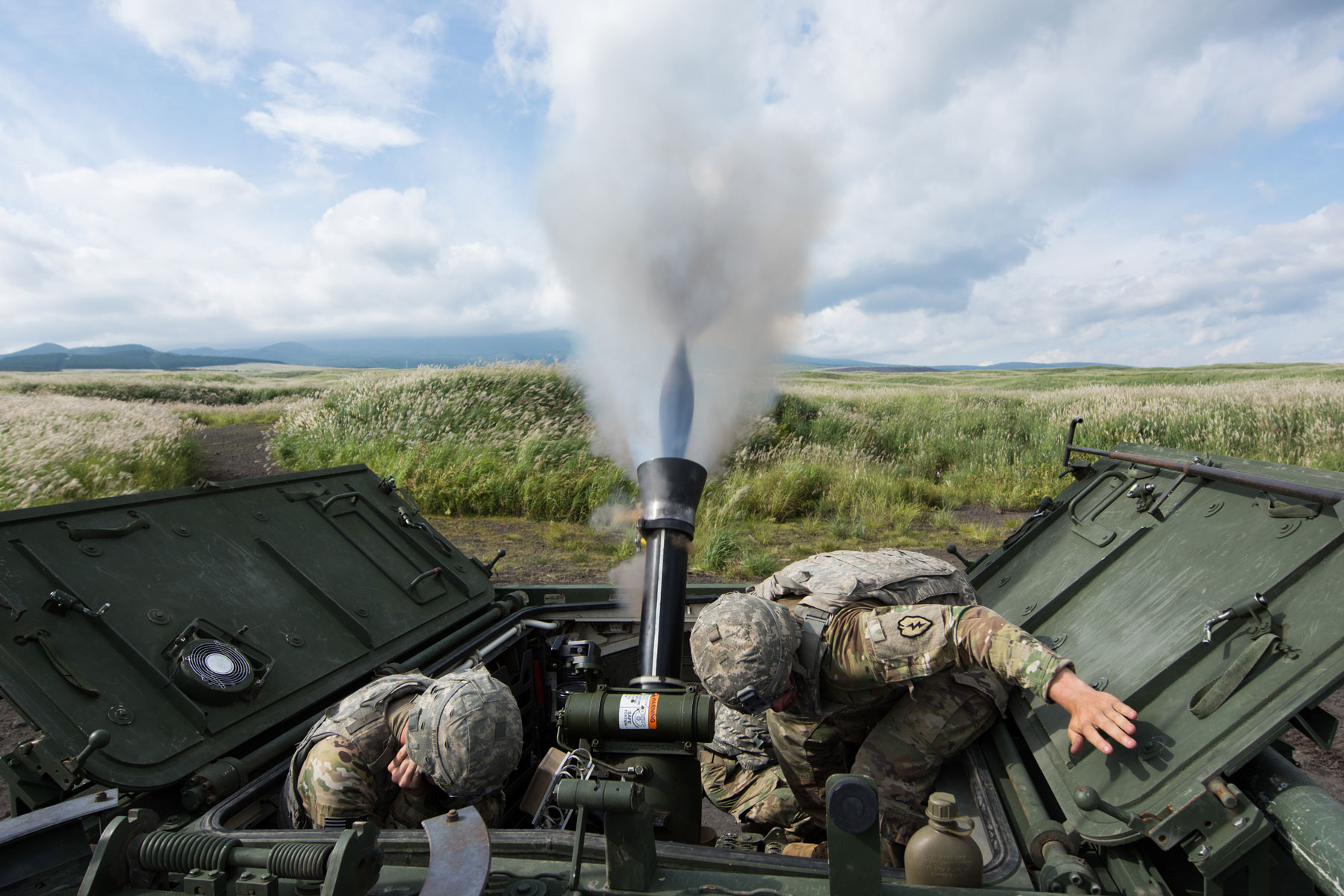 U.S. Army Soldiers assigned to Headquarters, Headquarters Company, 3rd Battalion, 21st Infantry Regiment, 1st Stryker Brigade Combat Team, 25th Infantry Division, conduct a live fire exercise utilizing a RMS6L 120mm mortar system on a M1129 Mortar Carrier as part of exercise Orient Shield 2017 at Camp Fuji, Japan.