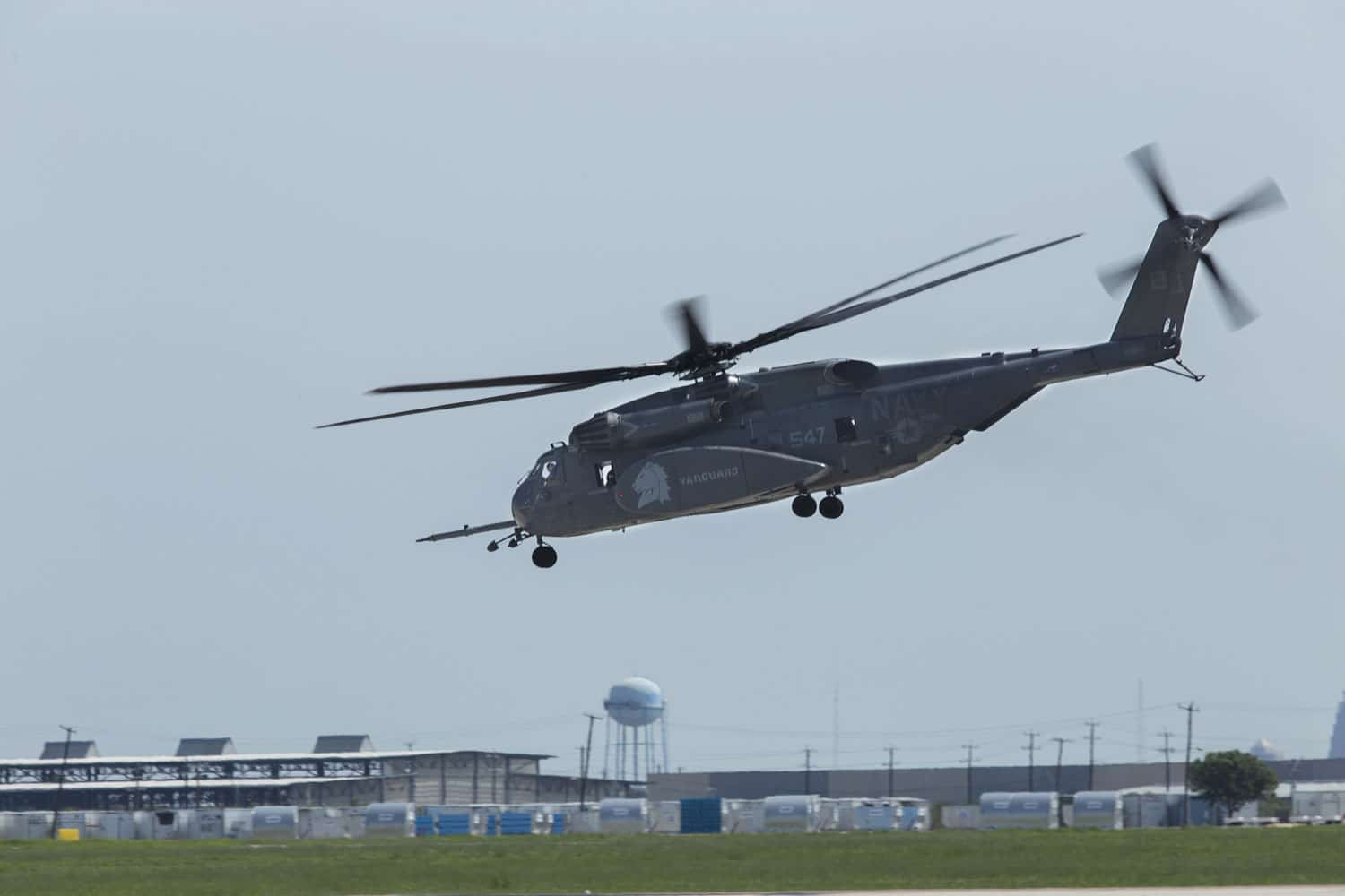 A Navy MH-53E Sea Dragon with Helicopter Mine Countermeasures Squadron 14 departs at Joint Base San Antonio-Lackland, Texas, for Hurricane Harvey relief missions.