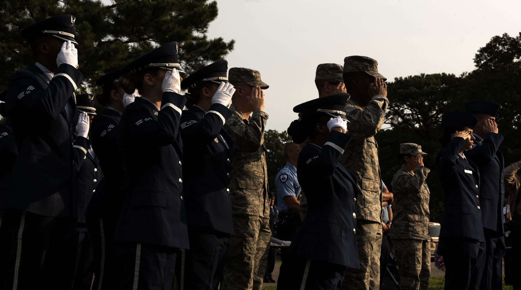 "United States Armed Forces service members and local authorities render a salute during the playing of Taps while attending ""The Reading of The Names"" at Gosnolds Hope Park, Hampton, Va., Sept. 11, 2017. The event was hosted by the City of Hampton, reading those lost on Sept. 11, 2001 and those who have made the ultimate sacrifice since Sept. 11, 2001 to Aug. 27, 2017."