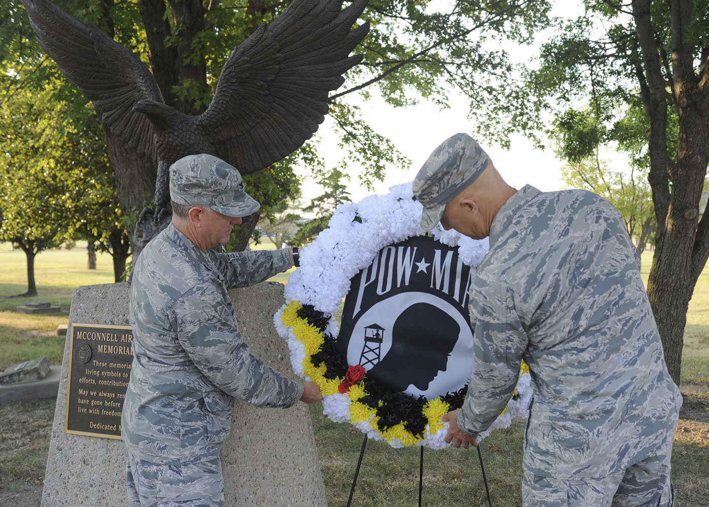 Col. Eric Vitosh, 931st Air Refueling Wing commander, and Col. Joshua Olson, 22nd ARW commander, place a POW-MIA wreath near the McConnell Memorial Walk as part of POW-MIA week Sept. 13, 2017, at McConnell Air Force Base, Kansas.
