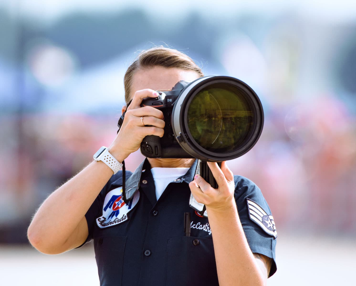 U.S. Air Force Staff Sgt. Tabatha McCarthy, U.S. Air Force Thunderbirds photojournalist, photographs an aerial demonstration during the 2017 Andrews Air Show: Air and Space Expo.