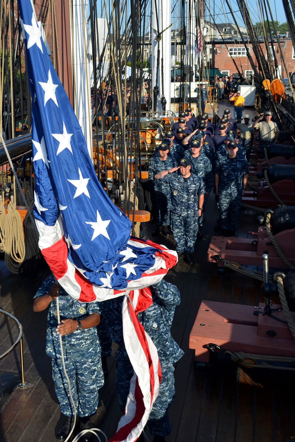 USS Constitution crewmembers and chief petty officer selects observe morning colors during USS Constitution's Chief Petty Officer Heritage Week. During the week the selects will live and train aboard USS Constitution, the world's oldest commissioned warship afloat.