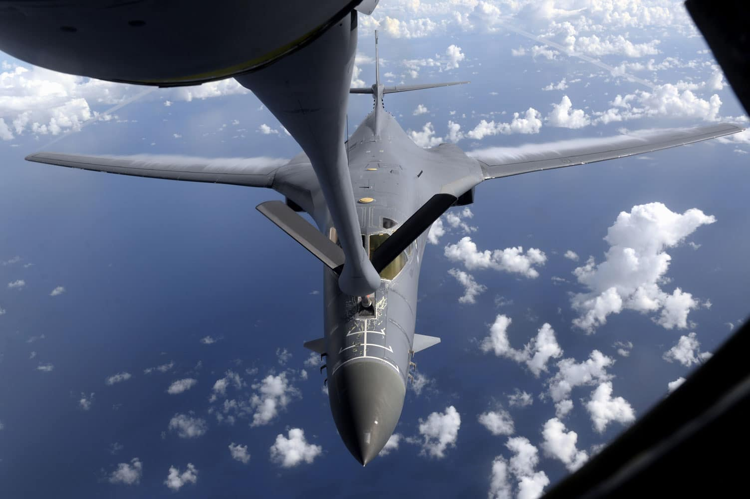 A U.S. Air Force B-1B Lancer, assigned to the 37th Expeditionary Bomb Squadron, deployed from Ellsworth Air Force Base (AFB), S.D., refuels over the South Pacific.