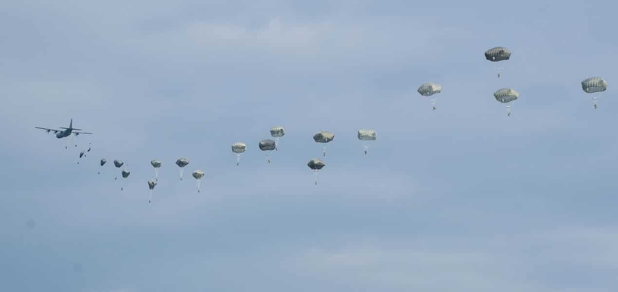 U.S. Army Paratroopers from the 173rd Airborne Brigade exit the C-130 Hercules in an emergency deployment training exercise.