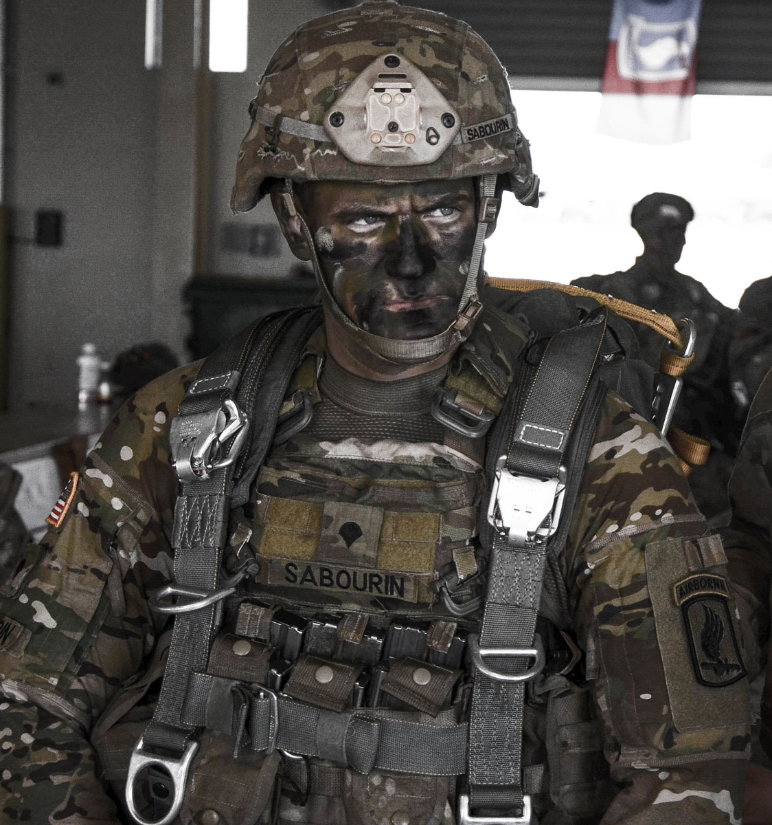 A First Rock Paratrooper of the 173rd Airborne Brigade United States Army is rigged and ready to air insert into a hostile environment.