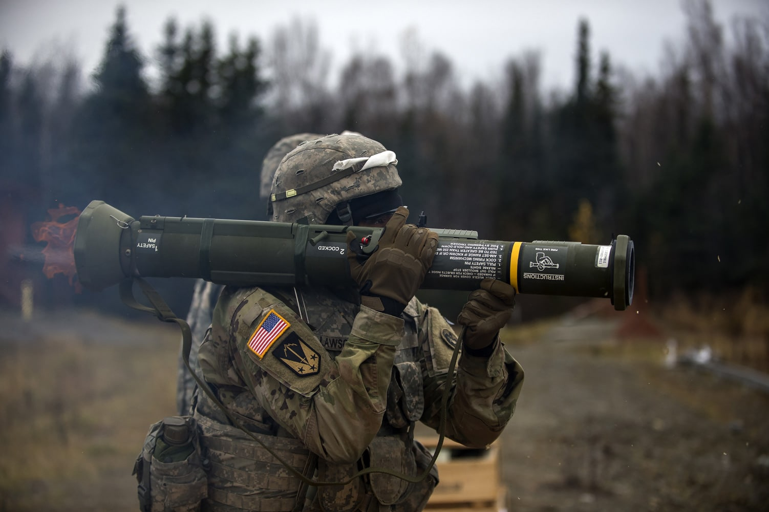 Army Sgt. Derek Lawson, assigned to the 109th Transportation Company, 17th Combat Sustainment Support Battalion, U.S. Army Alaska, fires the M136E1 AT4-CS confined space light anti-armor weapon at Joint Base Elmendorf-Richardson, Alaska.