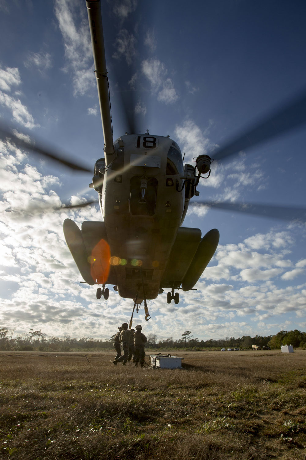 A U.S. Marine Helicopter Support Team is comprised of approximately eight landing support specialist Marines who ensure the equipment is properly attached and secured before pilots transport the gear or supplies to their destination.