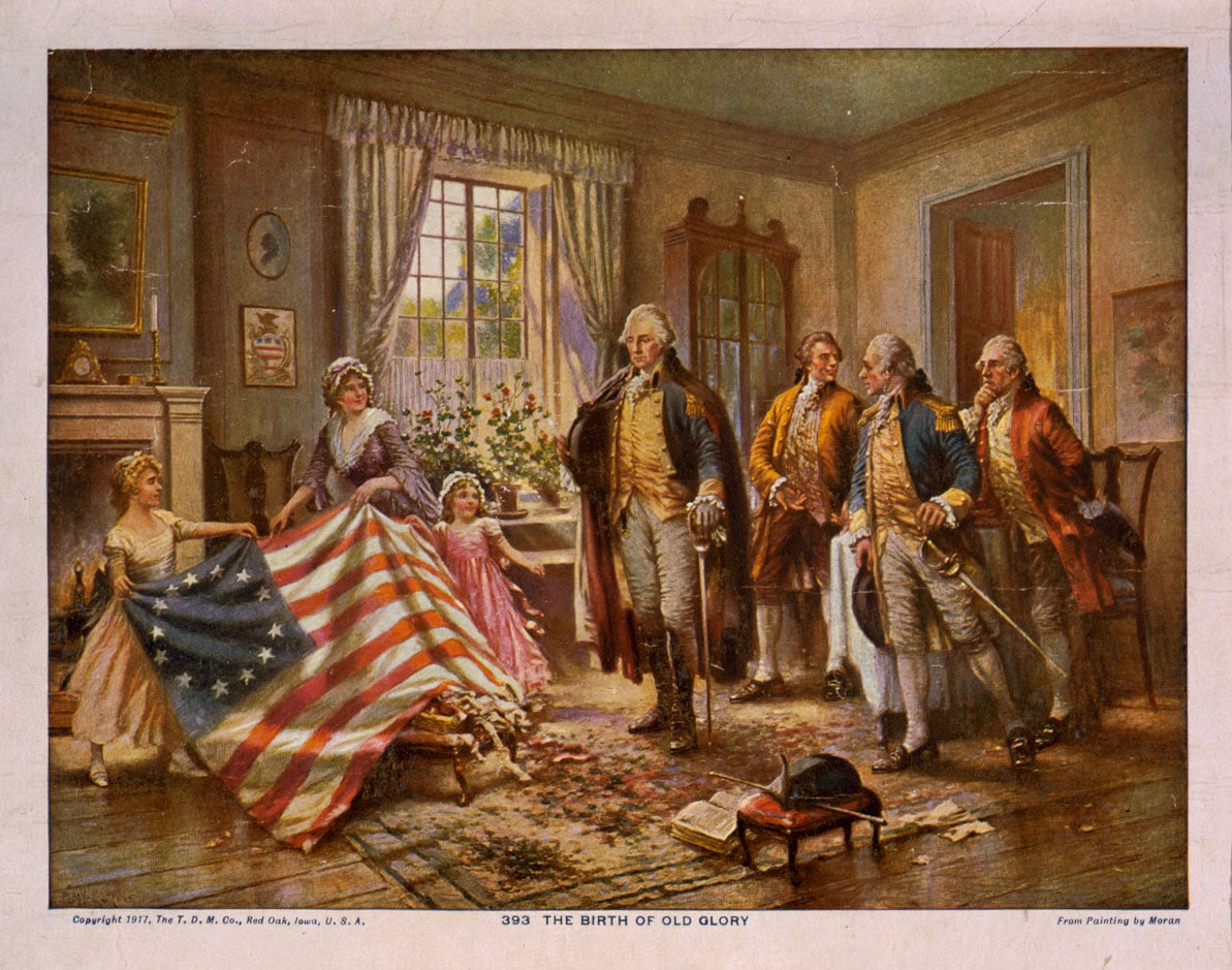 The Birth of Old Glory from Painting by Moran. Print shows an interior view of a room with Betsy Ross and two young girls on the left, showing an American flag to George Washington standing at center, and three other men standing on the right, possibly the Hon. George Ross and Robert Morris, and an unidentified military officer.
