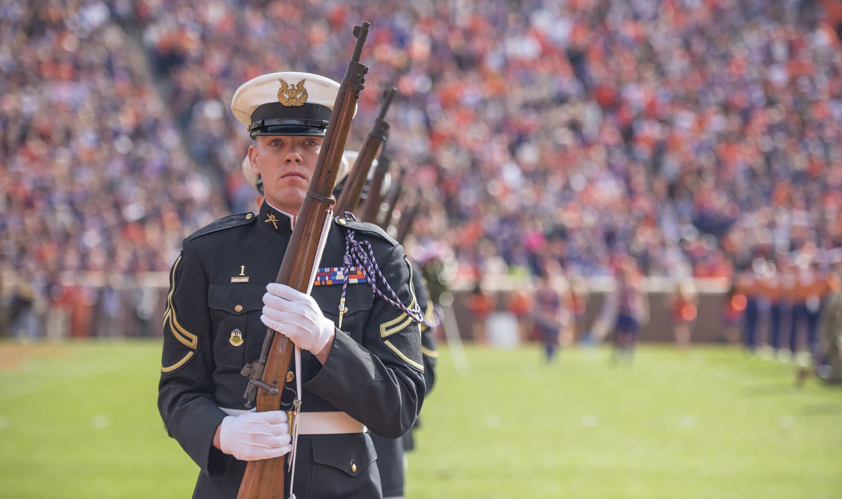A member of the Clemson University Pershing Rifles honor guard leads his team off the field of Memorial Stadium after the half-time ceremony honoring the fallen during the 2017 Military Appreciation Game.