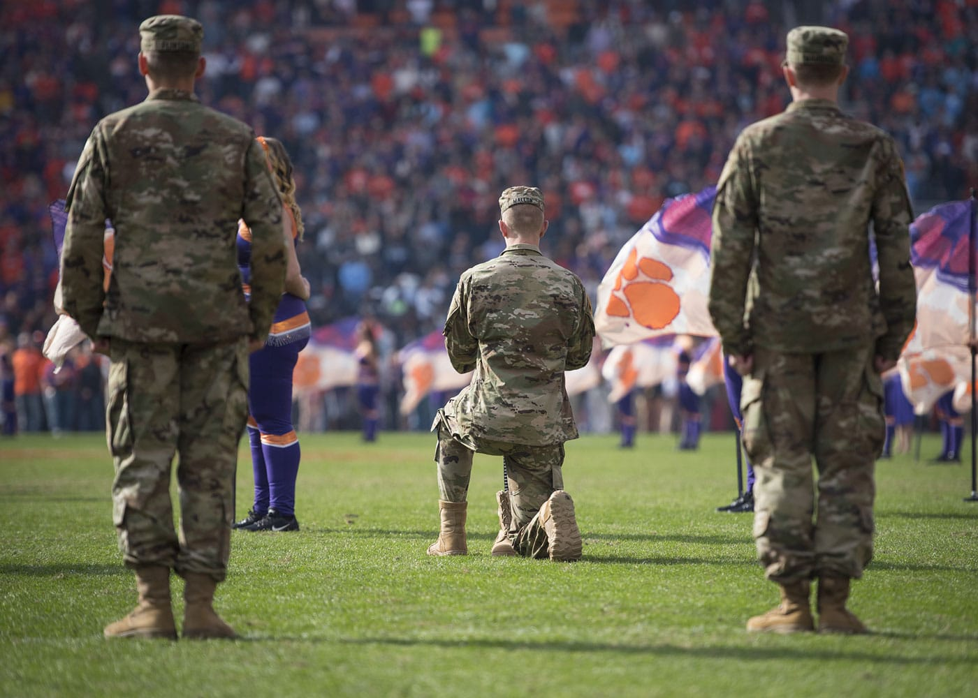 A cadet with the Clemson University Army Reserve Officers' Training Corps erects a Fallen Soldier Battle Cross during the half time ceremony of the 2017 Military Appreciation Game in Memorial Stadium.