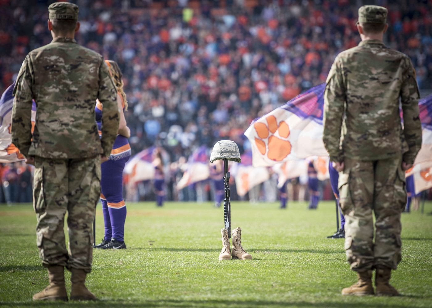 A Fallen Soldier Battle Cross sits mid-field as a crowd of more than 80,000 people observes a moment of silence to honor those who gave the ultimate sacrifice during the half-time ceremony of Clemson University's 2017 Military Appreciation Game in Memorial Stadium.