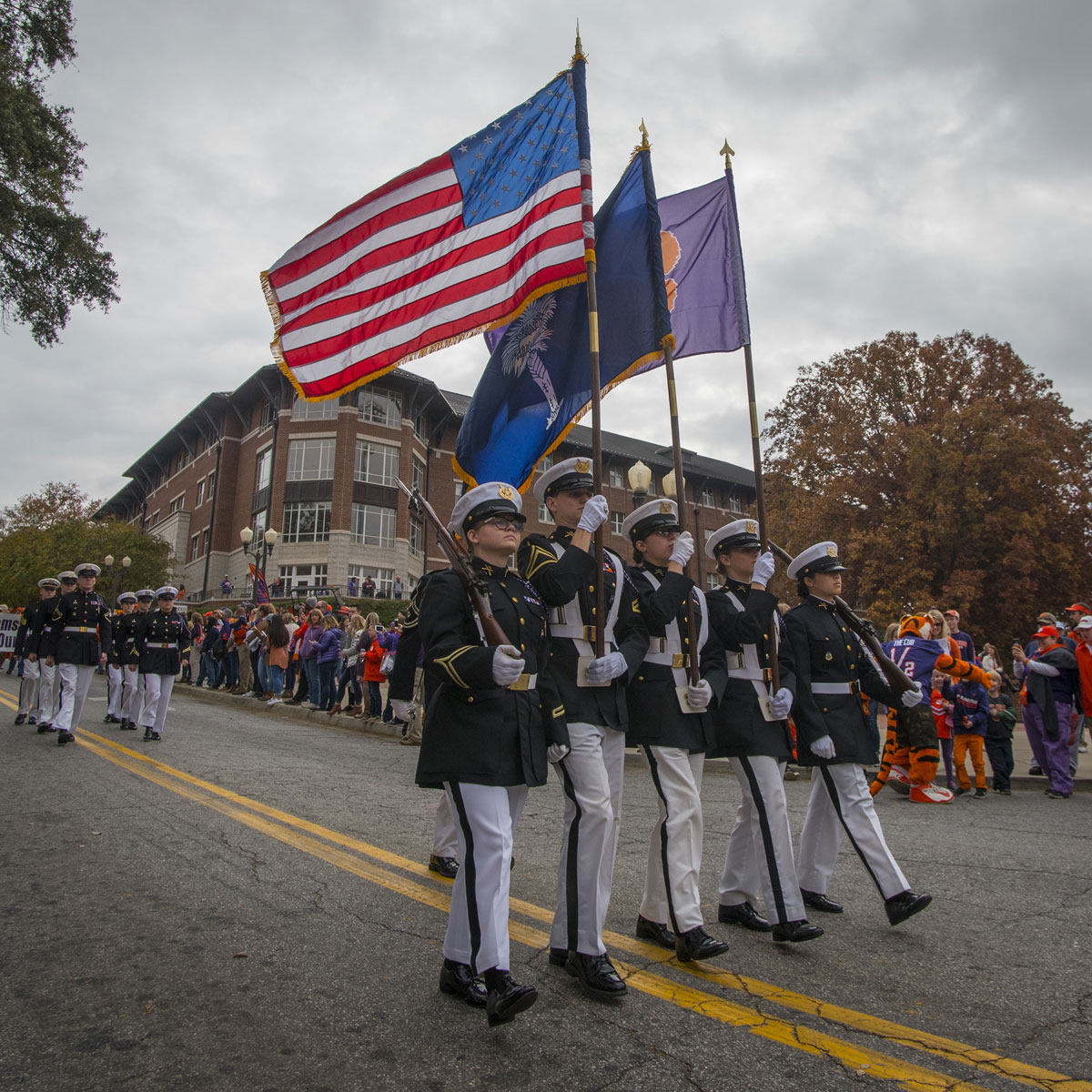 The Clemson University Pershing Rifles honor guard lead the parade into Memorial Stadium before the Tigers take on The Citadel Bulldogs in the 2017 Military Appreciation Game.