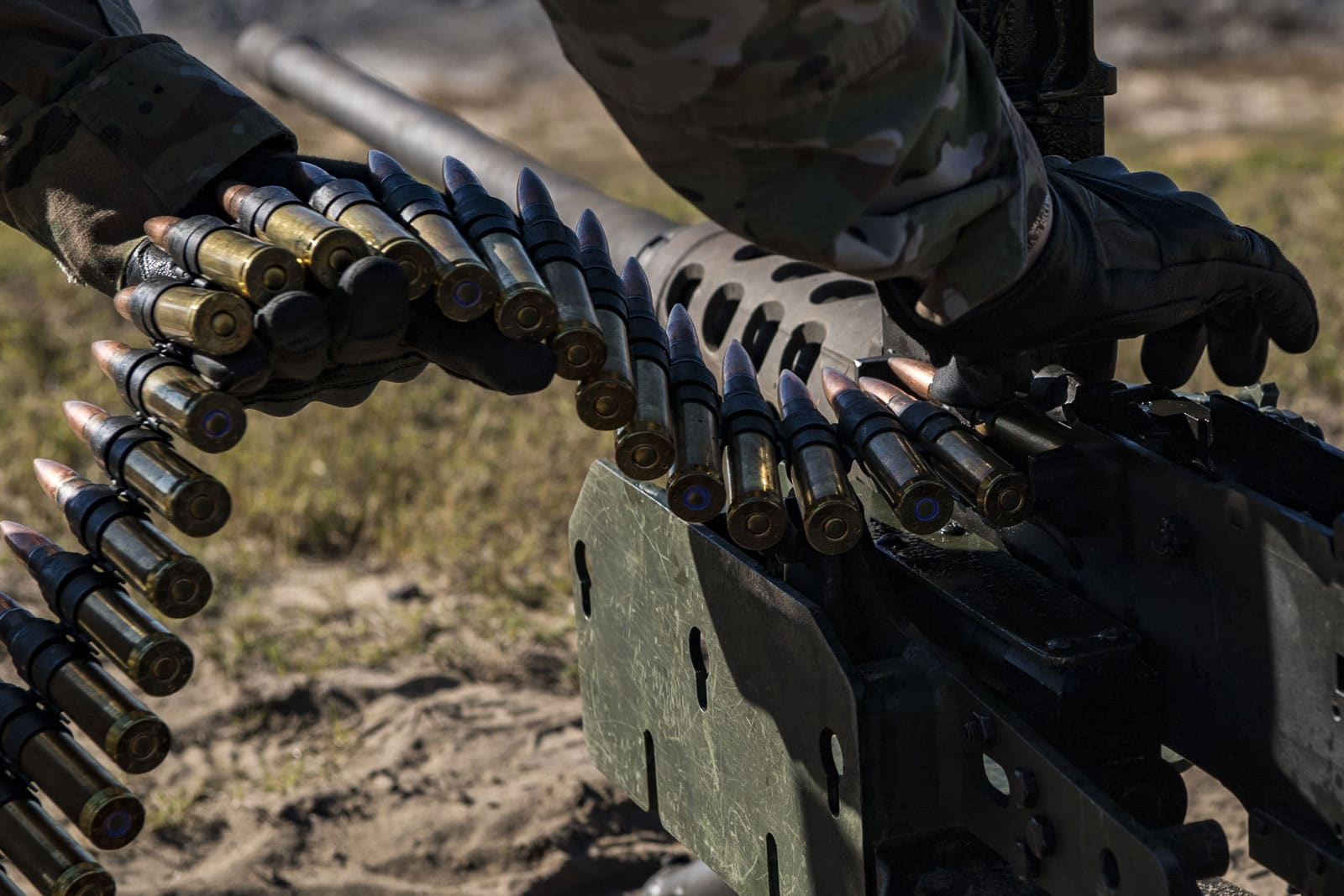 A United States Air Force Airman from the 823d Base Defense Squadron, loads a .50 Caliber M2 machine gun during a heavy weapons qualification.
