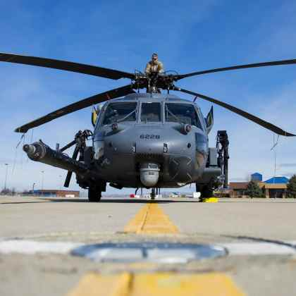 Master Sgt. Trevor Stevens, from the 943rd Rescue Group, examines the rotors of an HH-60G Pave Hawk helicopter, at Gowen Field, Idaho, during pre-deployment training for the 305th Rescue Squadron.