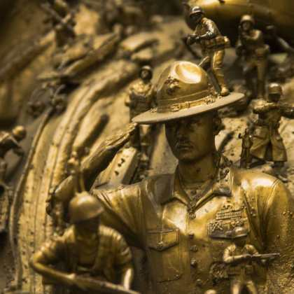 A drill instructor figurine, part of a much larger statue, holds a steady salute on its day of unveiling at the National Marine Corps Museum in Triangle, Virginia.