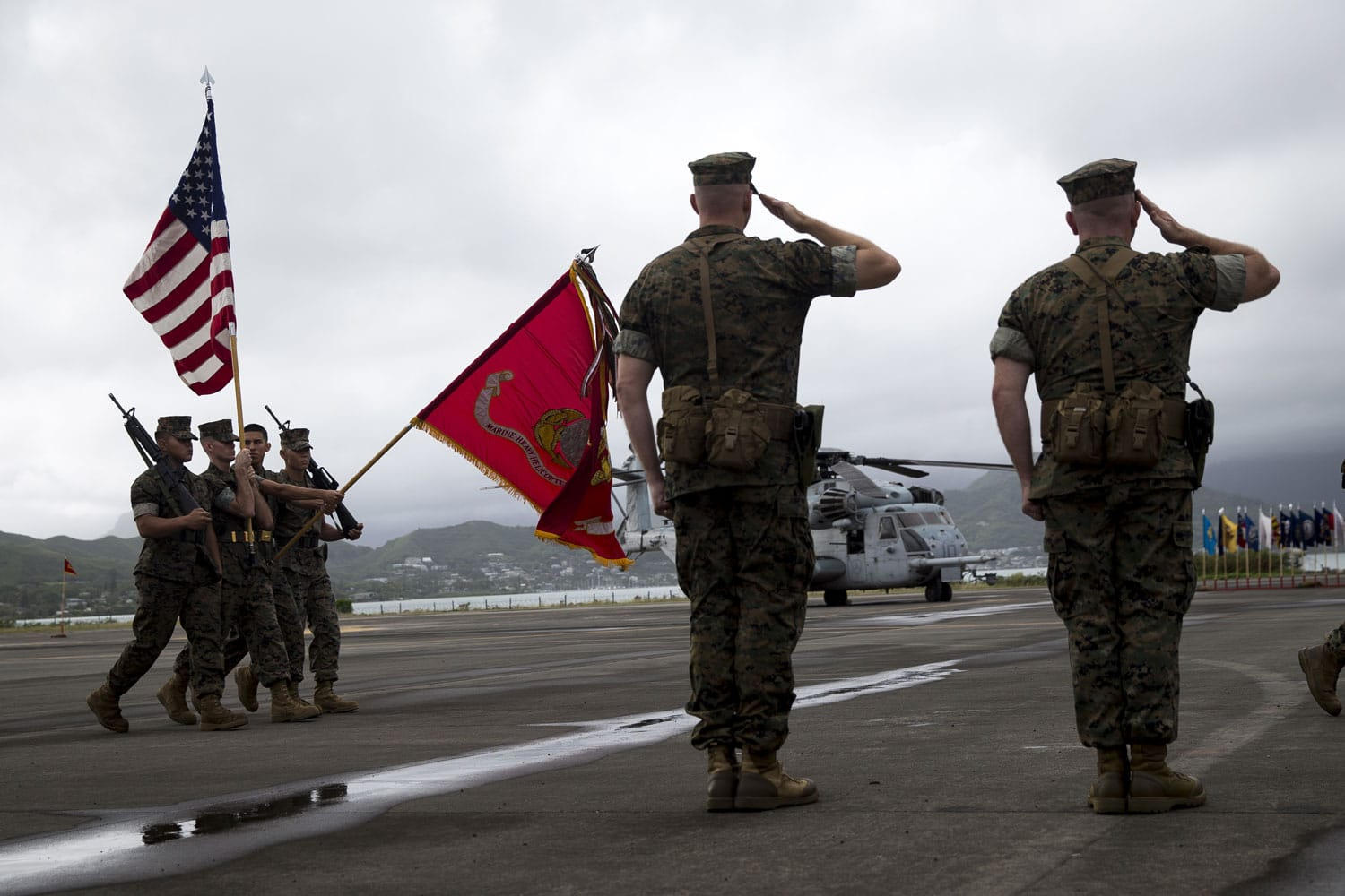 U.S. Marine Corps Lt. Col. Eric D. Purcell, off-going commanding officer, Marine Heavy Helicopter Squadron 463, and U.S. Marine Corps Lt. Col. Kevin G. Hunter, on-coming commanding officer, salute the colors during the Marine Heavy Helicopter Squadron 463 Change of Command aboard Marine Corps Base Hawaii.