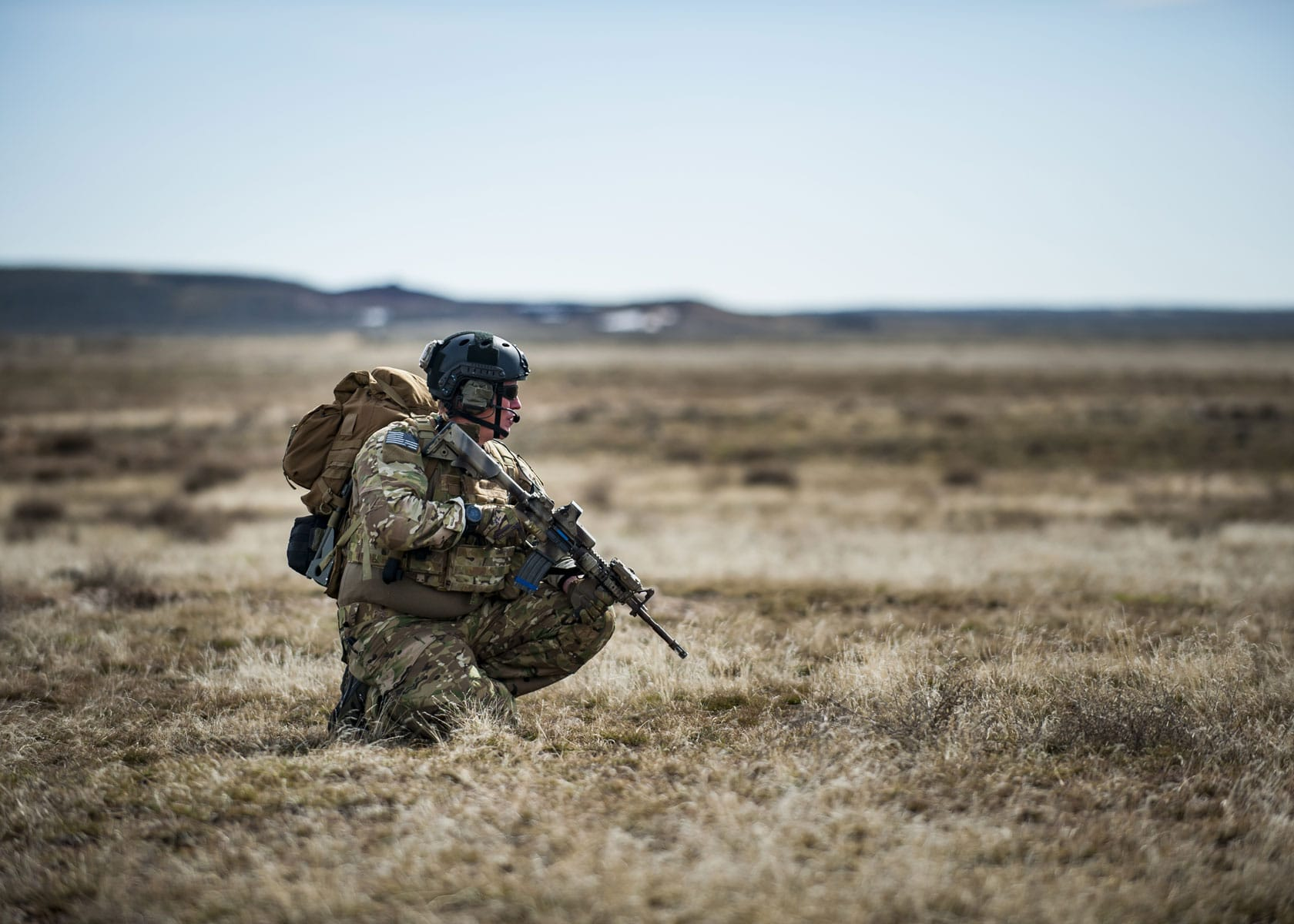 U.S. Air Force Chief Master Sgt. Mike Ziegler, 308th chief enlisted manager and pararescueman, watches his sector of fire.
