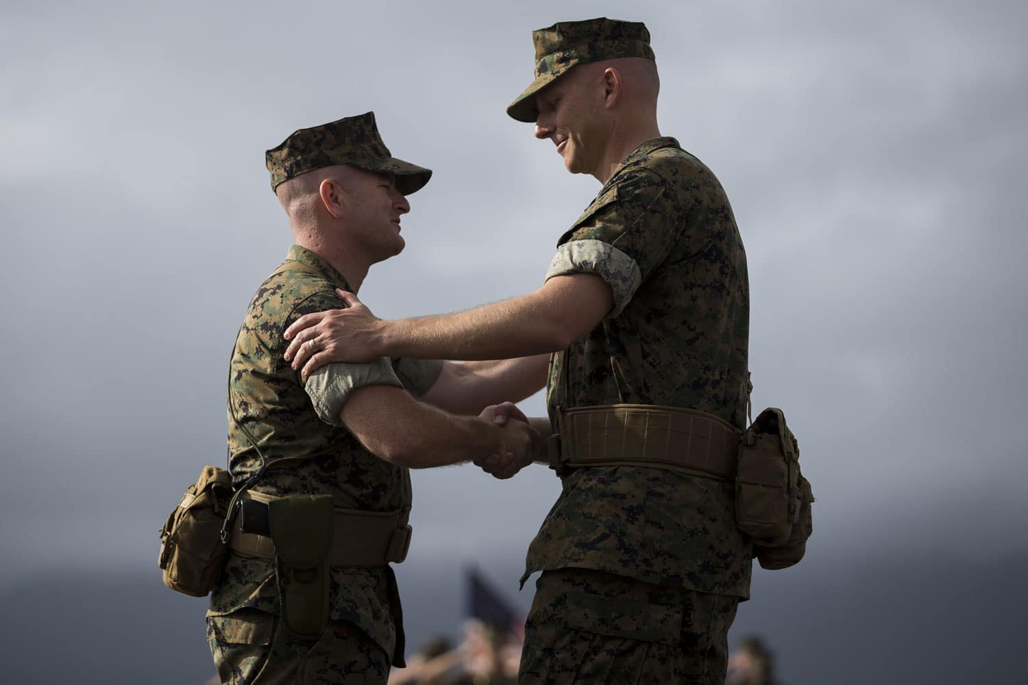U.S. Marine Corps Lt. Col. Eric D. Purcell, off-going commanding officer, Marine Heavy Helicopter Squadron 463, and U.S. Marine Corps Lt. Col. Kevin G. Hunter, on-coming commanding officer, share a handshake.