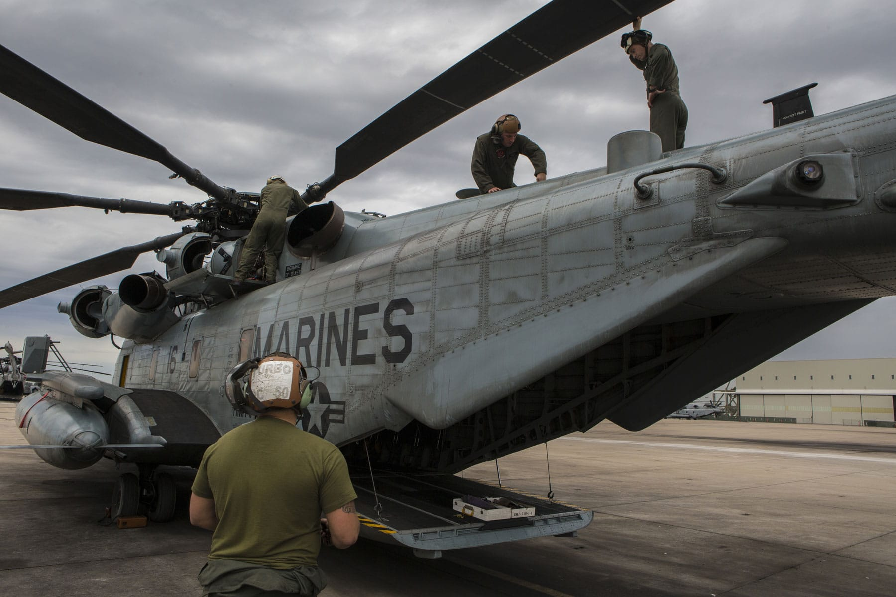 Maintainers with Marine Heavy Helicopter Squadron (HMH) 361 conduct a pre-flight check of a CH-53E Super Stallion at Marine Corps Air Station Miramar, California.