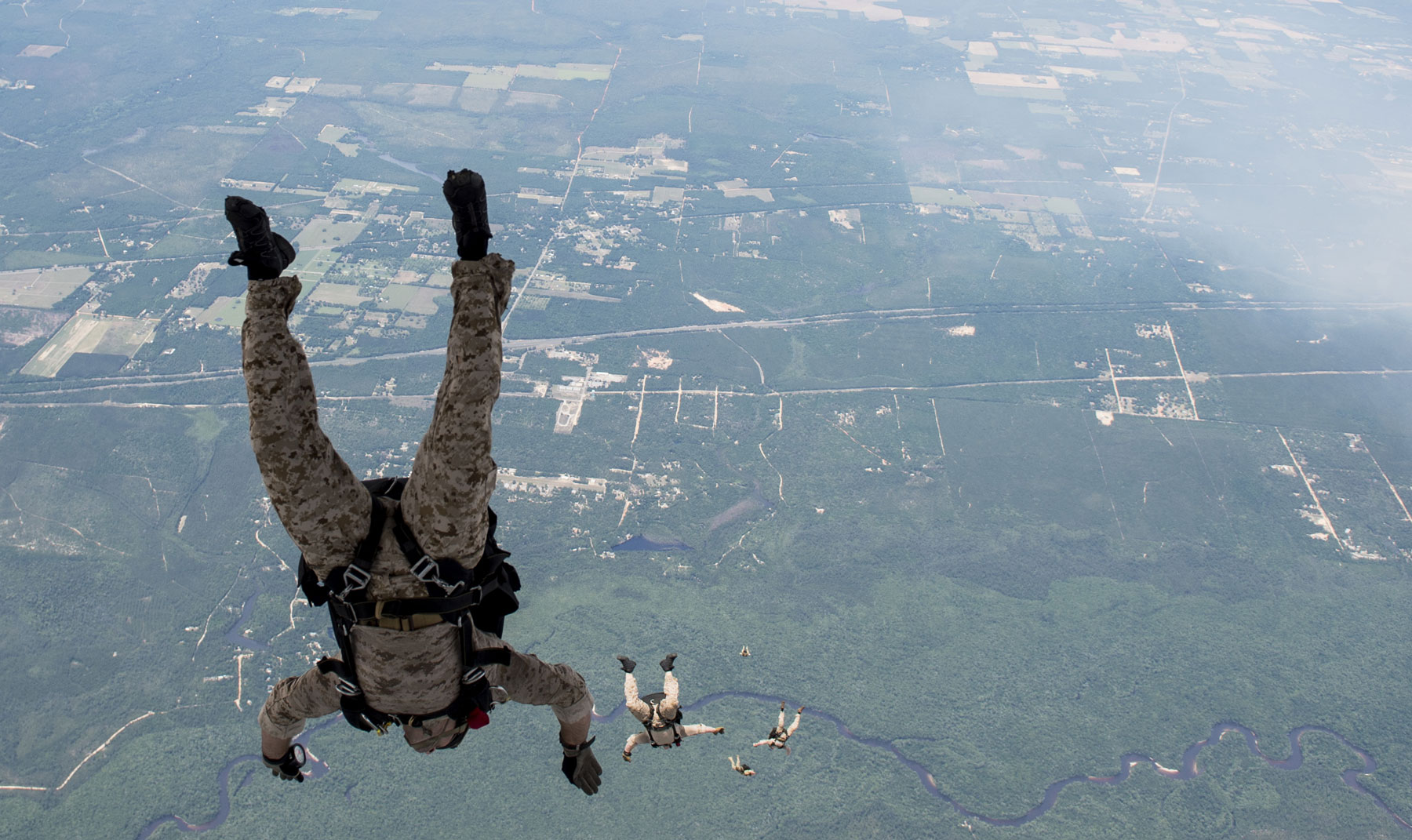 U.S. Navy Sea, Air, and Land Team Members conduct military free fall operations flying aboard a U.S. Air Force Special Operations Command MC-130 Talon II flown by the 19th Special Operations Squadron.