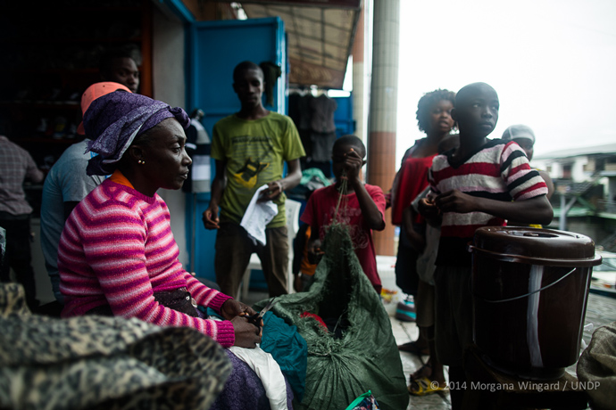 Anne Benson, 49, sells used clothes in Waterside Market to support her nine children and five grandchildren in Monrovia on September 18, 2014
