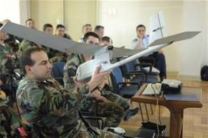 Chilean airmen examine a U.S. Air Force unmanned aerial system Oct. 29 at Quintero Air Base, Chile during an information exchange for Operation Southern Partner.