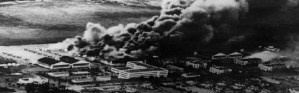 Aircraft burning at Wheeler Field with Schofield Barracks in foreground, 7 Dec 1941
