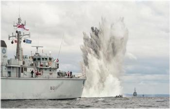 A United Kingdom HUNT Class ship conducting a controlled underwater explosion southwest of Bornholm, Denmark, during BALTOPS 2015
