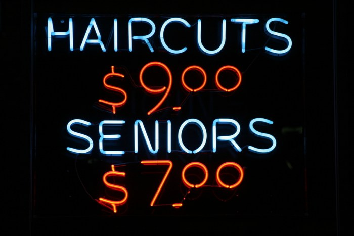"neon sign series ""haircuts $9.00, seniors $7.00"""