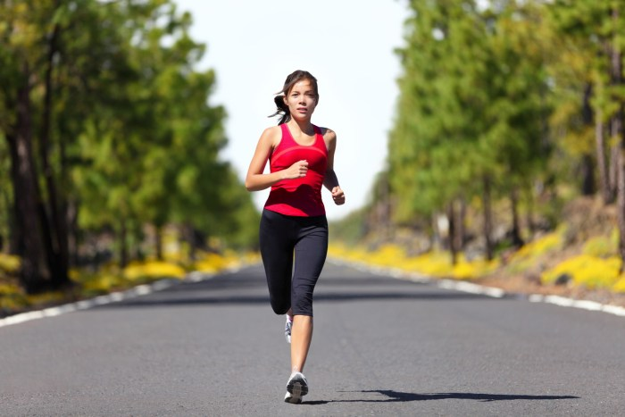 woman in a red shirt running