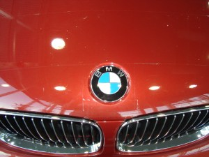 clearbra-competition-bad-work-vancouver-clearbra-bad-competition-work-2009-bmw-135i-red-brian-jessel-bmw-paint-protection-film-hood