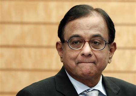 India's Finance Minister Palaniappan Chidambaram waits for the arrival of Japan's Prime Minister Shinzo Abe before their meeting in Tokyo