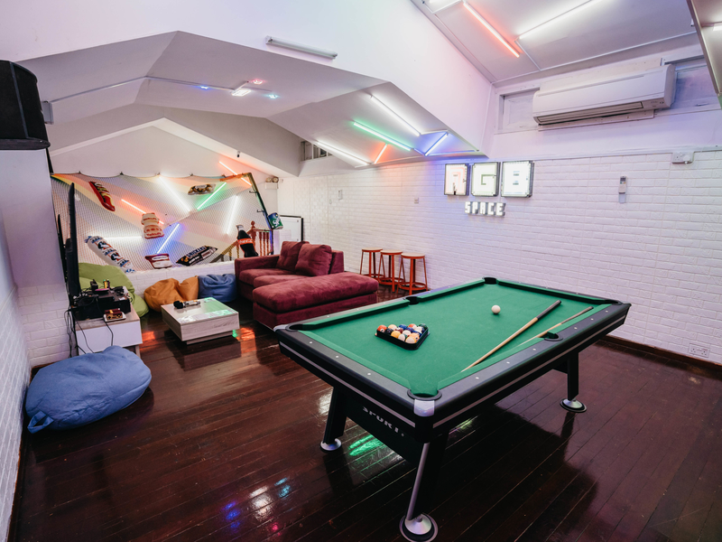cosy and comfortable event space with bean bags, cushions, consoles game and pool table