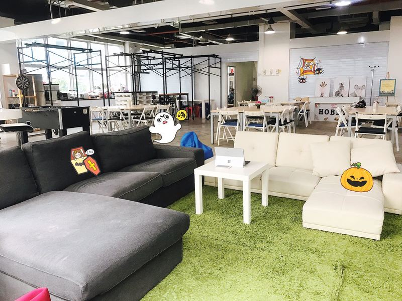 cosy and intimate space with couch and green carpet
