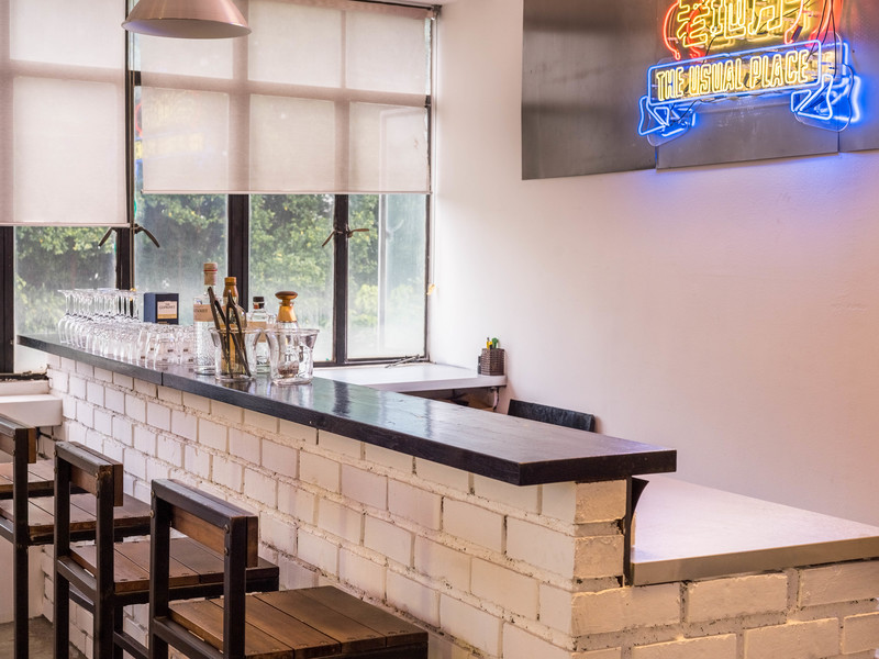 simple bar space with neon light sign