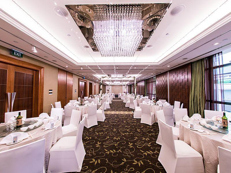 Beautifully decorated hotel ballroom wedding setup