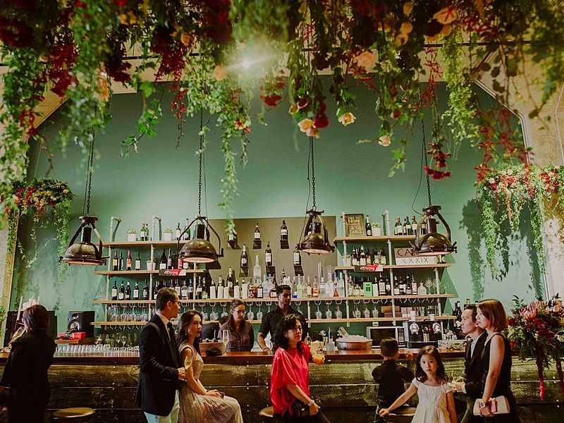 bar at cargo39 with beautiful floral decorations