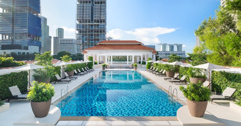 green tropical garden with swimming pool raffless hotel singapore