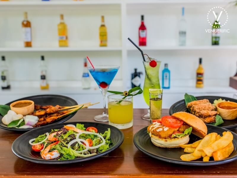 burgers salads cocktail on a table
