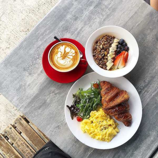 breakfast menu served with a cup of coffee