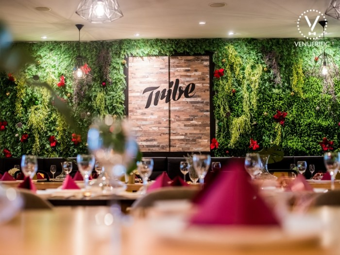 Tribe Singapore restaurant with green decoration