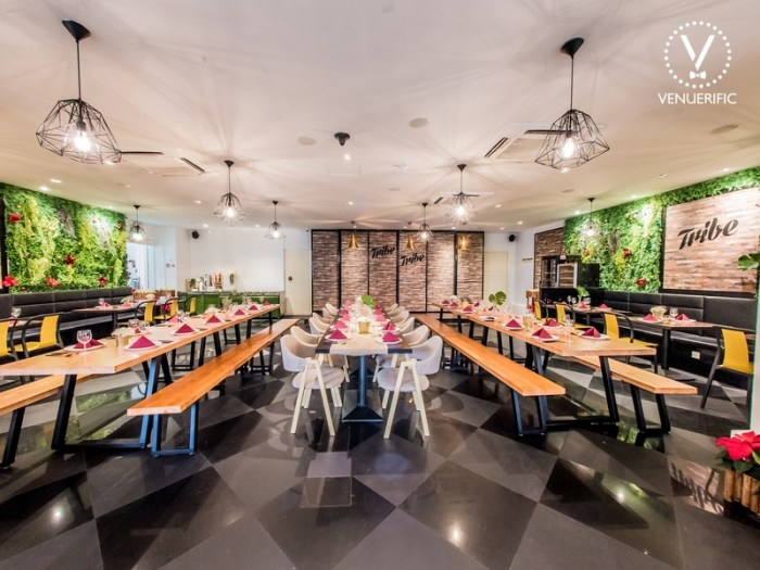 Minimalist restaurant with bright lighting and green decoration