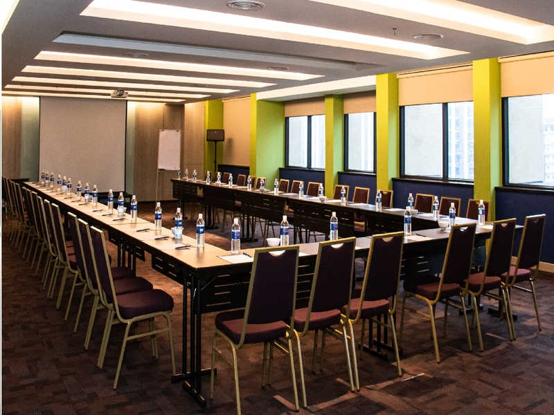 corporate meeting set in a nature themed meeting room