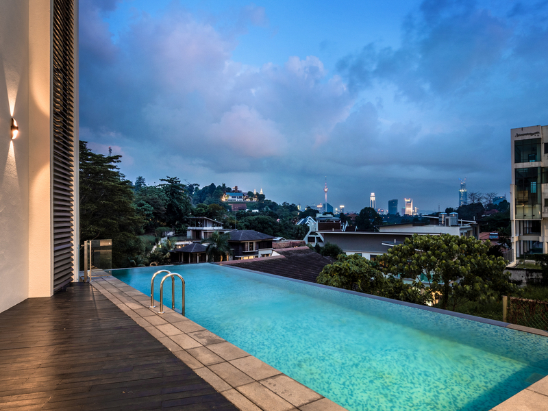 poolside view of the Kuala Lumpur skyline
