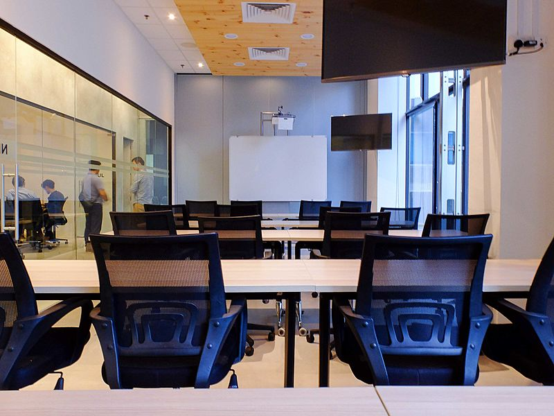 medium size meeting room in singapore with glass wall